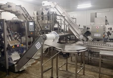 Fish portioning and packaging line